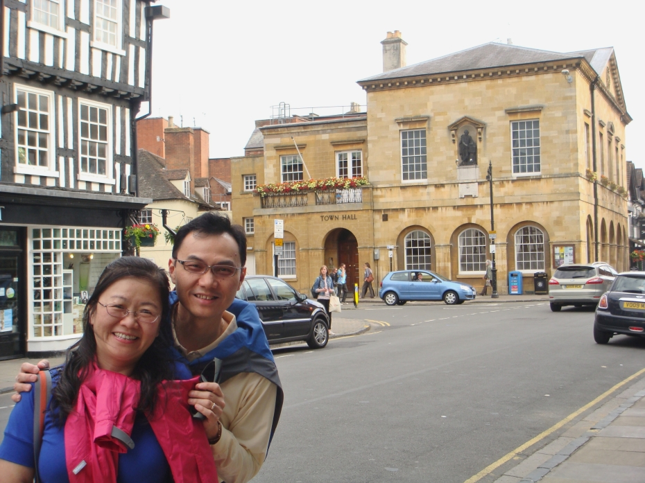 A happy couple smiling away in the town centre. You would love to walk in these streets.