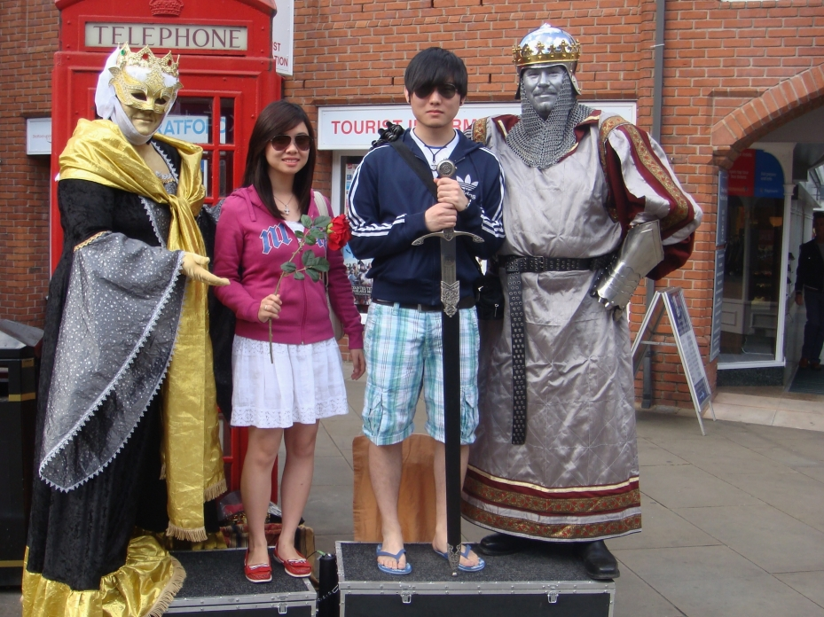 "My two children standing between a ""king"" and a ""queen"" - we have to pay to take pictures with them though"