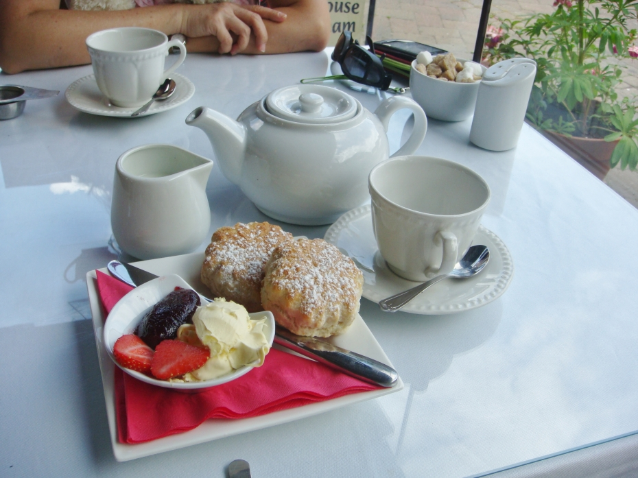 Henry had his favorite scone and tea set in a cafe by the quiet waters.